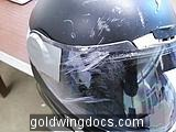 Broken helmet but intact head