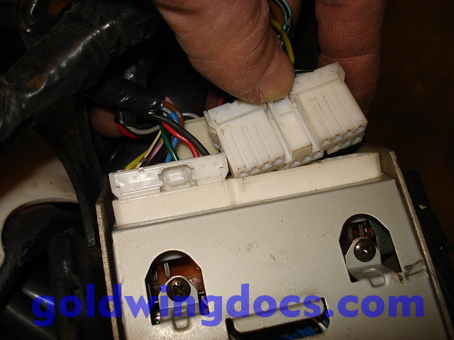 pull the rubber boot down over the connectors, and make sure it is held in  place over the tab in the metal bottom of the radio